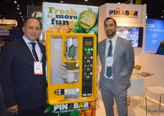Remy Cima and Michel Keeken with Dutch Food Technology proudly show the Pinabar. In a matter of seconds, this machine peels and cuts pinapples and drops the chunks in a ready-to-go container.
