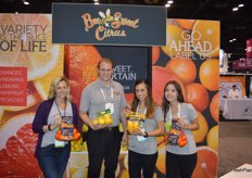 The team of Bee Sweet Citrus was visited by team members from Produce for Kids. From left to right: Lesley Daniels with Produce for Kids, Andres Skooglund and Monique Bienvenue with Bee Sweet Citrus and Grace Vilches with Produce for Kids. They proudly show mesh bags with mandarins as well as classic lemons Meyer lemons.