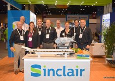 Sinclair just launched a new logo. The team of Sinclair in the new booth with the V6 High Speed Labeling machine in front.