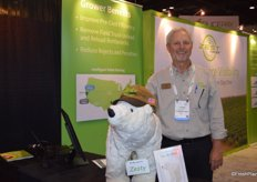 Kevin Payne with Zest Labs proudly takes a picture with Zesty, the company mascot.