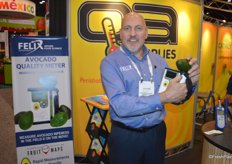 Leonard Felix proudly shows the company's new avocado meter that attracted many visitors to the booth.