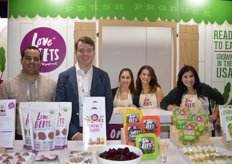 The team of Love Beets proudly show all the products they have on display.