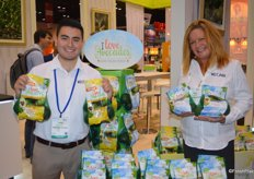 Joshua Estebane and Kim Kinnavy with West Pak Avocado, Inc. show I Love Avocodos in mesh bags.