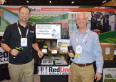 Adrian Down and Todd Bagget with RedLine Solutions proudly show different scanners that help with inventory management.