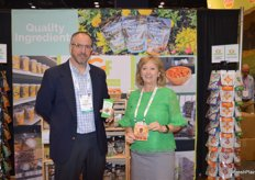 Chad Hartman and Angela Bauer with Truly Good Foods proudly show the Fruit Bowl and Buffalo Nuts products.