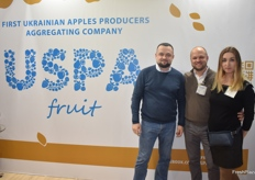 Volodymyr Gurzhiy, Dmytro Kroshka and Sophia Kushch from the USPA, a Ukranian company showcasing their apples.