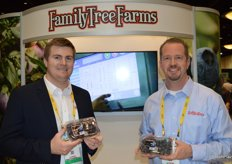Brenton Helm and Doug LaCroix with Family Tree Farms show clamshells with blueberries from Mexico.