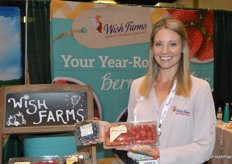 Amber Maloney with Wish Farms proudly shows blueberries and raspberries.
