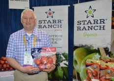 Dan Wohlford with Starr Ranch shows new branding on a pouch bag of Pink Lady apples. Starr Ranch did a company re-brand at the end of last year.