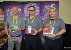 Produce like its 1999. Purple is the color in the booth of Mucci Farms. From left to right: Steve Zaccardi, Nick Allen and Danny Elias, showing Cucumber Poppers, Smuccies and Cherto tomatoes.