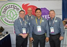 The team of Naturipe Farms in its rebranded booth. From left to right: Joe Dugo, Kasey Kelley, German Llanten and Archie Taylor.