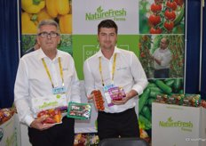 Ray Wowryk and Matt Quiring with NatureFresh Farms show mini sweet peppers as well as Tomz in topseal packaging.