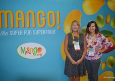 Tammy Wiard and Michelle Larkin in the colorful booth of the National Mango Board.