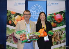 Showing a selection of organic products from Awe Sum Organics are Kirk Crane and Jenn Heinlein.