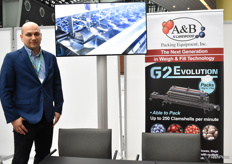 Piotr Milewski from AB Packaging promoting a blueberry packing machine.