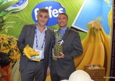Juan Alarcon and Jack Howell with the Tropical Division of Fyffes North America show bananas and pineapples.