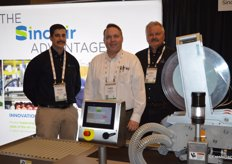 Kevin Guadagnini, Chris Faxon and Mark Reed with Sinclair International stand behind a pattern labeling machine.