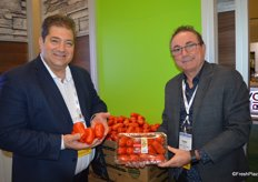Dino Dilaudo and Tony Cappelli with Westmoreland-TopLine Farms show greenhouse grown San Marzano-style Roma tomatoes. They are available in bulk as well as packaged.