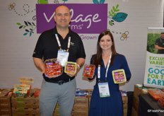 Andrew Sable and Avery LeFils with Village Farms show different tomato varieties and packaging.