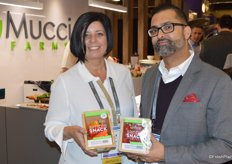Emily Murracas and Ajit Saxena with Mucci Farms proudly show the companys new Simple Snack packaging. The Simple pack is made of cardboard with 100% recyclable lidding film.