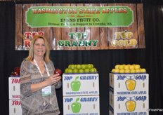 Kristina Conrad with Evans Fruit Company shows a Red Delicious apple that is shipped all over the globe.