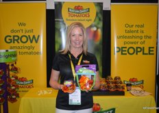 Heather White with NatureSweet shows a tomato medley and sweet mini peppers from the companys Brighthouse Organics line.