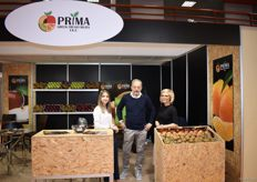 Noppie Nikolaidou and two of his employees for the company Prima Greek Fresh Fruits. They deal in apples, oranges and kiwis.