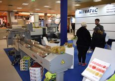 Novatec's stand, they showed off their machinery that wraps the produce in plastic.
