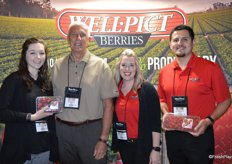 Jim Grabowski with Well Pict is flanked by Lauren Melenbacker, Johnna Johnson and Anthony Donilla of Marketing Plus. Lauren and Anthony proudly show strawberries and raspberries.
