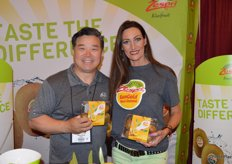 John Kang and Melanie Stavinski with Zespri are excited for the New Zealand kiwifruit season. They are proudly showing Sun Gold kiwis.