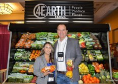 Valerie Gonzales and Dave Hewitt with 4Earth Farms show Fiesta peppers and a 3 ct. organic pepper.