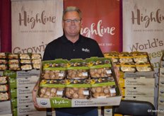 John Sheehan with Highline Mushrooms shows organic Mini Bella mushrooms in top seal packaging.