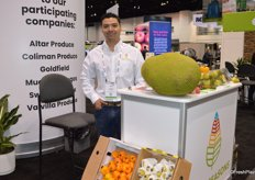 Yasmani Garcia with Sweet Seasons has several produce items from Mexico on display, including jackfruit.