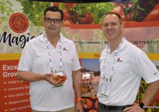 Alejandro Santander and Tony Otto with MagicSun show two new products: mixed tomatoes and organic grape tomatoes.