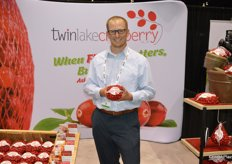 Kevin Tritz with Twin Lake Cranberry out of Wisconsin proudly shows a mesh bag with cranberries.