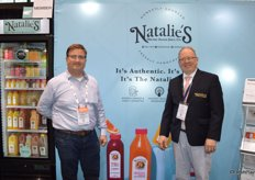 Michael Ward and Michael DAmato with Natalies Orchid Island Juice Company offer juice samples to show attendees.