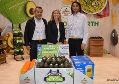 The team of Avocados from Mexico in front of a Superbowl display: Oscar Garcia, Tanya Edwards and Ryan Fukuda.