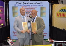 RJ Hassler and his dad Rick Hassler proudly show a larger size Food Freshness Card for retail. A smaller version can easily be put in the refrigerator at home and prevents mold development. For the third year in a row, the company won the Innovation Award for Best Food Safety Solution.
