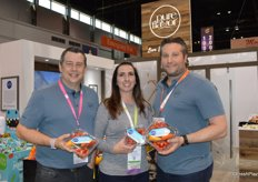Chris Veillon, Melissa Moore and Jamie Moracci with Pure Flavor show the companys newest snack pack that includes tomatoes, mini cucumbers and sweet mini peppers.
