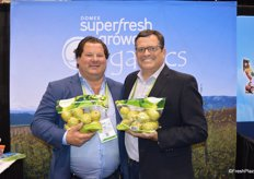 Paul Newstead and Mike Preacher with Domex Superfresh Growers show 3 lb. pouch bags of DAnjou pears.