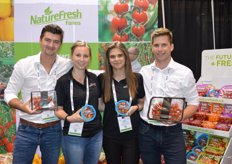 Matt Quiring, Sarah Krzysik, Kara Badder and Conor Chilvers with NatureFresh Farms. Sarah and Kara show the Worlds Smallest Tomatoes while Matt and Conor show a new premium black label for cherry tomatoes on the vine. Two more items for the black label are in the works and will be launched at PMA.