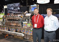 Trevor Brummel with AB Packaging and Bart Johnson with Automated Packaging Systems stand next to the AB Lakewood Evolution weigh filler.