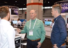 Robert Verloop with Coastline Family Farms stops by the Aerobotics booth to learn more about the company.