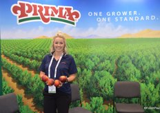 Brittnie Hammack with Gerawan Farming shows Prima peaches out of California's Central Valley. Harvest of the Prima series started mid-May.