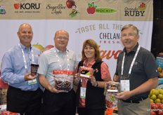 The team of Chelan Fresh proudly shows new harvest of Northwest cherries. From left to right; Mac Riggan, Jim Busche, Denise Hinkley and Jay Dyer.