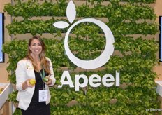 Natalie Shuman with Apeel shows untreated versus Apeel-treated citrus.