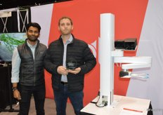 Akash Nandi and Josh Lessing with Root AI proudly show the award and the tomato-harvesting robot.