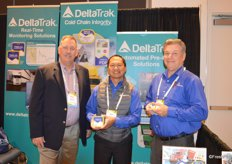 From left to right Robert Bright, Rolan Ramirez and Kevin Manning with DeltaTrak. Rolan holds the Real-time logger that measures temperature and humidity. Kevin shows the FlashLink Mini PDF.