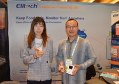 Min Cui and Zhaobin Han with Elitech show different temperature data loggers.