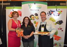Kristina Lorusso, Kristin Lopez and Gary Caloroso with Giumarra. Kristina proudly shows a pouch bag of persimmons. Giumarra has the largest persimmon program in the country and the first varieties will be available as of September.